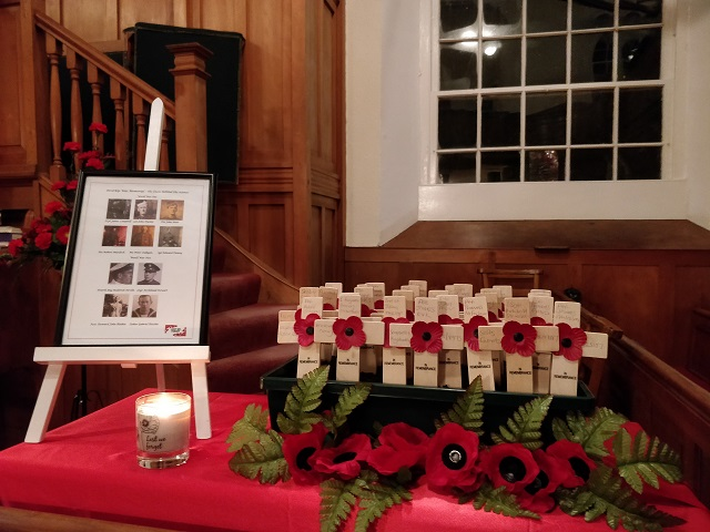 Inverkip Parish Church, in Renfrewshire. There were individual crosses for each of the 29 men on the war memorial and photographs of some of the men. The crosses were then moved to the war memorial at the end of the service.