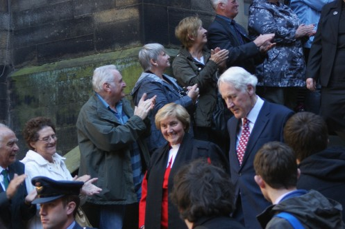 The Rt Rev Lorna Hood and the Lord High Commissioner, Baron Douglas of Selkirk are clapped out of the General Assembly