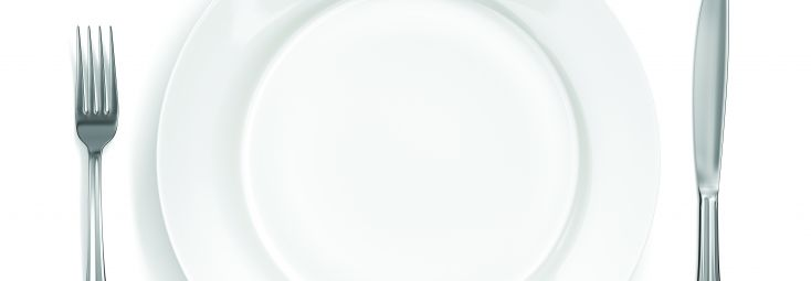 Knife, fork and white dinner plate
