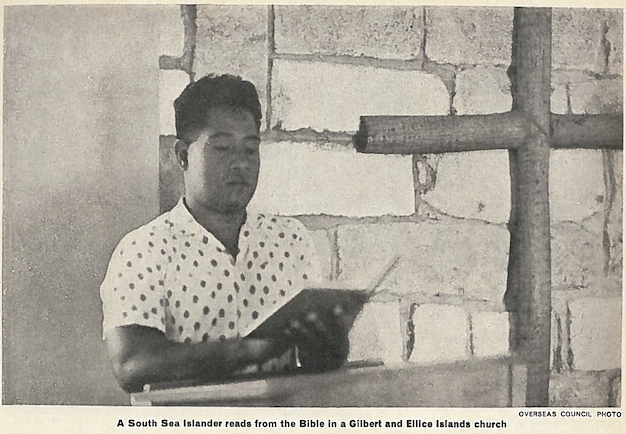 Black and white image of a South Sea Islander reading from the Bible in church.