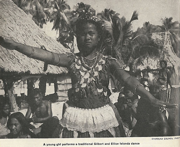 Black and white image captioned: A young girl performs a traditional Gilbert and Ellice Islands dance